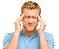Worried young man suffering from headache Stock Photography