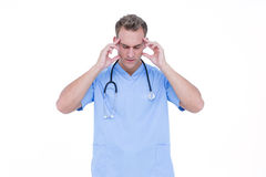 Worried young nurse in blue tunic Royalty Free Stock Photos