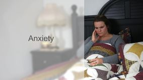 Worried Young twenties woman in bed typography - Anxiety Version stock video footage