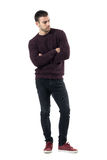 Worried young upset man in sweater with crossed arms looking down. royalty free stock photo