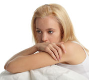 Worried young woman. On bed Stock Photos