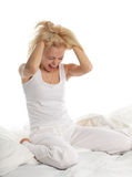 Worried young woman. On bed Royalty Free Stock Image