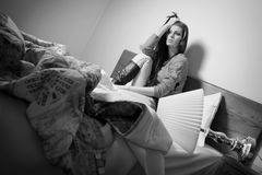 Worried Young Woman. A worried and afraid young woman in bed Stock Photography