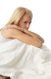 Worried young woman. On bed Stock Images