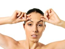 Worried young woman checking wrinkles on forehead royalty free stock photos