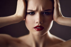 Worried young woman Stock Photography