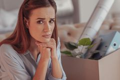 Worried young woman propping her chin with hands royalty free stock image