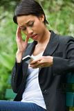 Worried Young Woman Reading Text Message Stock Images