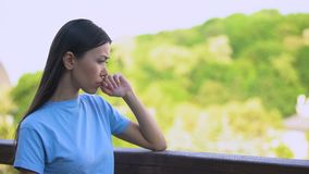 Worried young woman thinking problem standing outdoors house backyard, anxiety. Stock footage stock footage