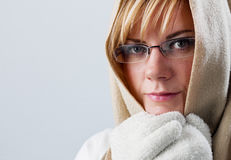 Worried young woman in winter with cape Royalty Free Stock Photos