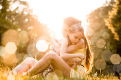Worries of childhood. Mother is cuddling her worried child outdoor in nature Royalty Free Stock Images