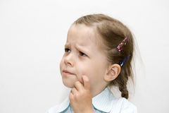 Worries small young girl Stock Photo