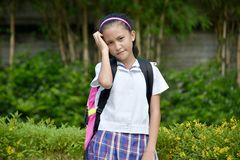 Worrisome Girl Student Wearing School Uniform With Books