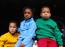 Worry. Three children sit onto of a car with a worried expression on their face Royalty Free Stock Photos