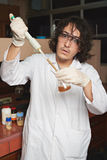 Worry chemist with water sample Stock Photography