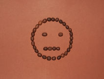 Worry face made of coffee beans Stock Images
