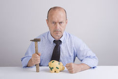 Worry. A man worry in front a piggy bank Royalty Free Stock Images