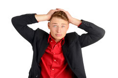 Worry, sadness, desperation. Young business man holding his head frowning with worry. Man with different facial expressions. Isolated on white background Royalty Free Stock Photography