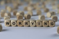 Worrying - cube with letters, sign with wooden cubes Royalty Free Stock Photography