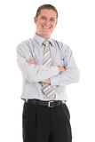 Worryless. Smiling businessman in blue shirt black trousers with his arms crossed Royalty Free Stock Photo