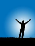 Worship. Silhouette of a man with arms stretched out to the sky Stock Images