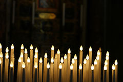 Worship. Electric candles in a church used for worshiping and showing of faith Royalty Free Stock Images
