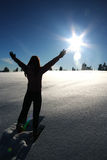 Worship. A woman worships the warmth of the sun on a cold winter day Royalty Free Stock Photo