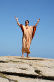 Worship. Man with arms raised to the sky in worship Stock Photo