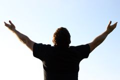 Worship. Man with hands lifted high Stock Image