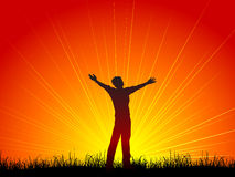 Worship. Silhouette of a man with his arms outstretched in worship Royalty Free Stock Photography