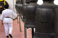 Worship with bell. In buddhist temple royalty free stock photos