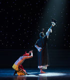Worship on bended knees-Chinese folk dance fan method Stock Photography