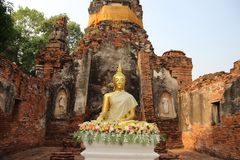 Worship. Buddhist Temple  And Old Stupa With Bricks Walls royalty free stock photo