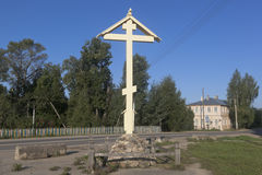 Worship cross on the site of the destroyed during the Soviet era temple Great Martyr Paraskeva in the city of Totma stock images