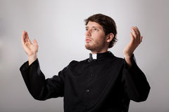 Worship for God. Cleric worshiping God with all his heart stock image
