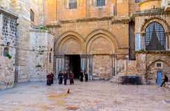 After the worship. JERUSALEM, ISRAEL - FEBRUARY 18, 2016: The Franciscan monks leave the Church of the Holy Sepulchre after the worship, on February 18 in Stock Photography