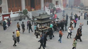 Worship at Jing'an temple in Shanghai stock video