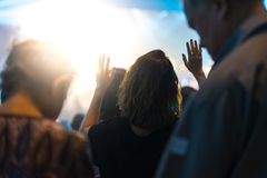 Worship night. Christian worship with raised hand and pray in the worship concert Royalty Free Stock Photos