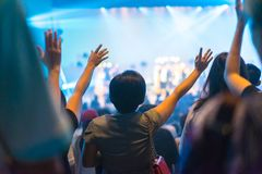 Worship night. Christian worship with raised hand and pray in the worship concert Stock Images