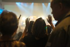 Worship night. Christian worship with raised hand and pray in the worship concert Stock Photos