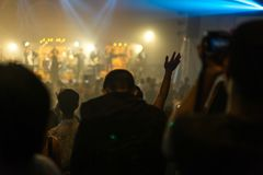 Worship night. Christian worship with raised hand and pray in the worship concert Stock Image