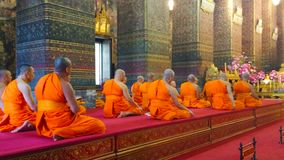 Worship in Phra Ubosot of Wat Pho, Bangkok, Thailand. BANGKOK, THAILAND - APRIL 22, 2019: The bhikkhu monks pray during the worship in Phra Ubosot of Wat Pho stock footage