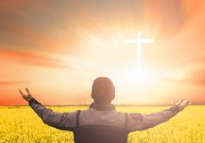 Worship and praise concept: Silhouette many people raised hands over sunset background. World environment day concept:beautiful meadow wallpaper background royalty free stock images