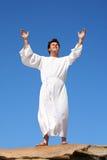 Worship praise happiness. A man raises his arms  heavenward in an act of praise or worship Stock Photos