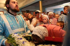 Worship of shrine. Russia. Tomsk. An elderly woman was praying before the icon in the Orthodox church Royalty Free Stock Image