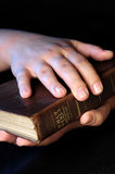 Worship time. A view with hands and bible during worship time Stock Photo