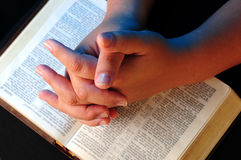 Worship time. A view with hands and bible during worship time Royalty Free Stock Images