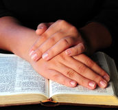 Worship time. A view with hands and bible during worship time Royalty Free Stock Photo