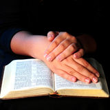 Worship time. A view with hands and bible during worship time Royalty Free Stock Image