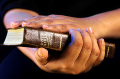 Worship time. A view with hands and bible during worship time Stock Photography